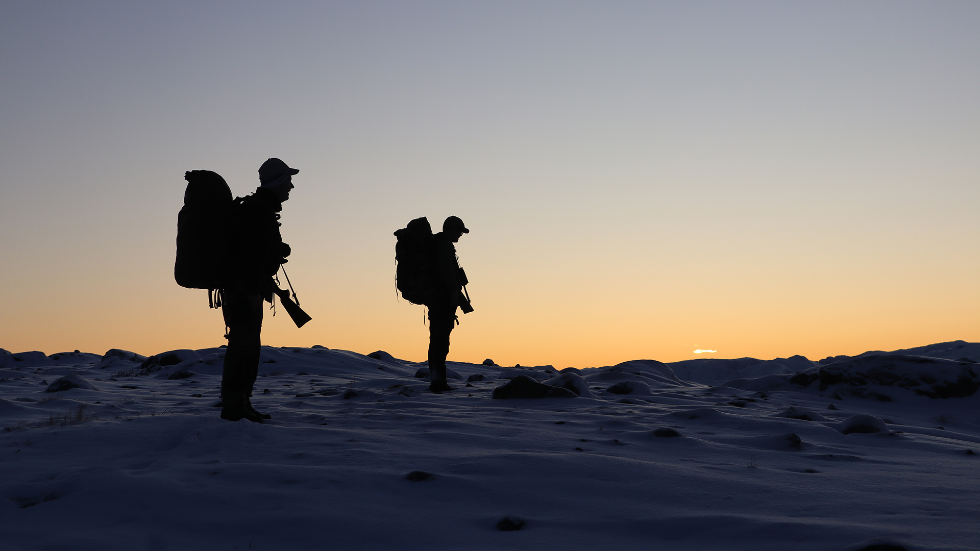 Hunters in the sunset.