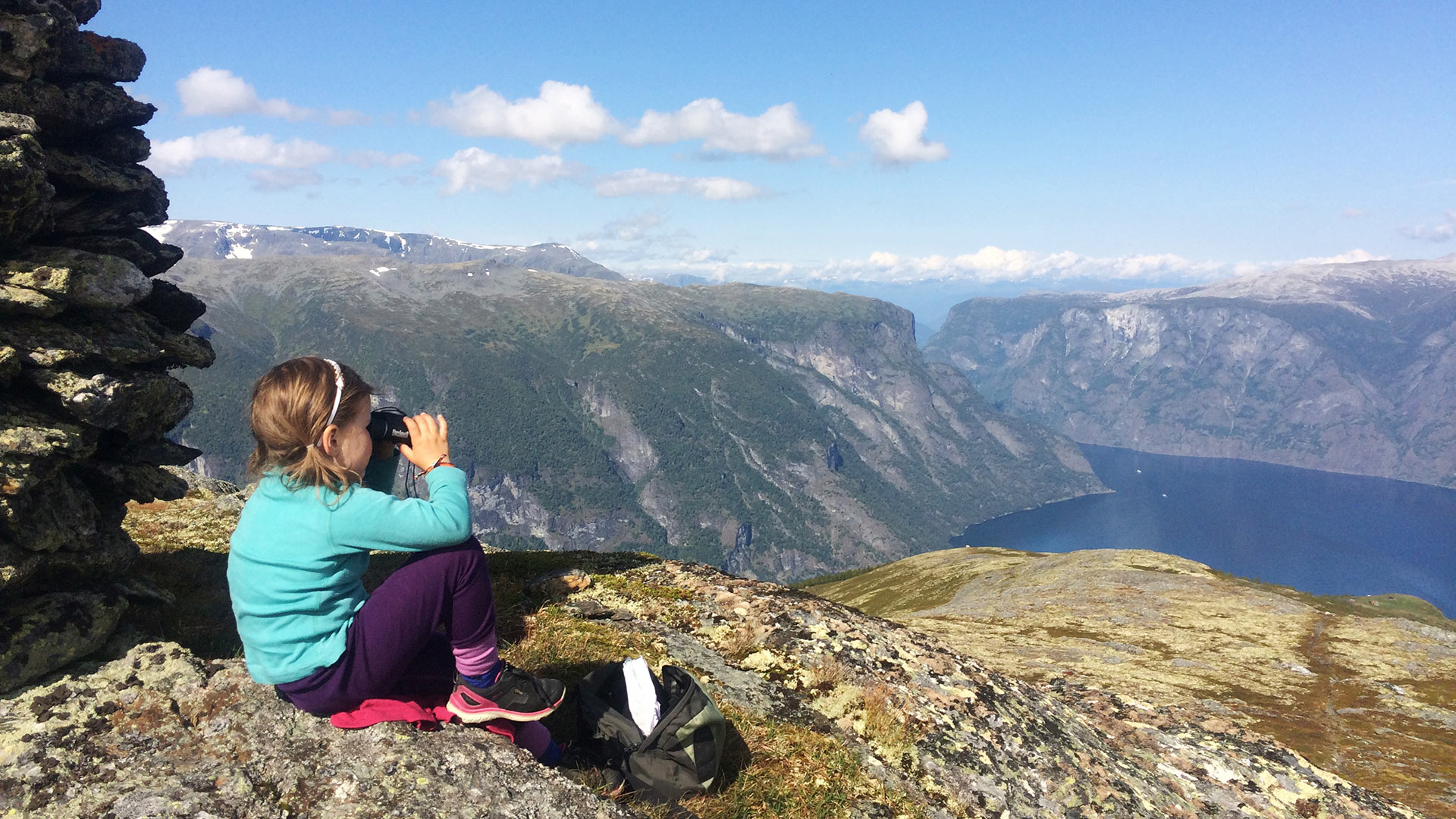 Child looking at the view over the fjord.