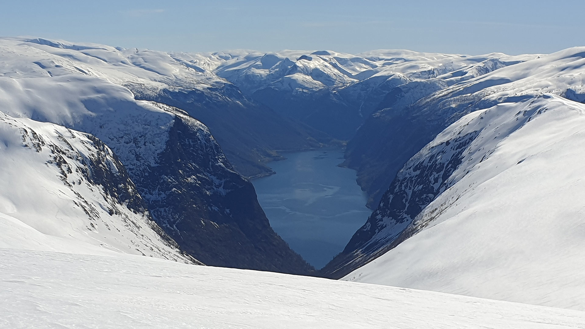 View over fjord and mountains.